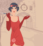 Flapper girls set: vintage woman in1920s style. Dresses standing on the street of old town Royalty Free Stock Photography