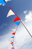 Flapping coloured flags. Red, white and blue bunting at a summer fete in England, UK Royalty Free Stock Photography