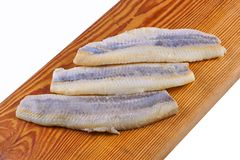 Flaps of herring. On a white background Royalty Free Stock Photo