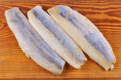 Flaps of herring. On a white background Stock Photography