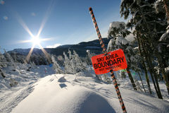 Flare. THe sun shines brightly over Whistler mountain stock images