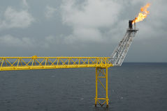 Flare boom nozzle and fire on offshore oil rig Royalty Free Stock Photo