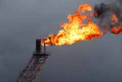 Flare boom on offshore oil rig Stock Photos