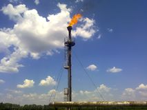 Flare for flaring associated gas. The end point of the pressure. Relief system on the oil facility Royalty Free Stock Image