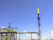 Flare for flaring associated gas. The end point of the pressure relief system on the oil facility. Flare for flaring associated gas. The end point of the Stock Images