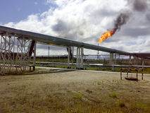Flare for flaring associated gas. The end point of the pressure relief system on the oil facility. Flare for flaring associated gas. The end point of the Stock Photography
