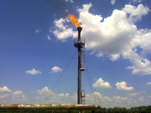 Flare for flaring associated gas. The end point of the pressure relief system on the oil facility. Flare for flaring associated gas. The end point of the Royalty Free Stock Image