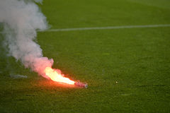 Flare on football pitch. During the match between Dinamo Bucharest and Steaua Bucharest, Romania First Football Division Royalty Free Stock Photo