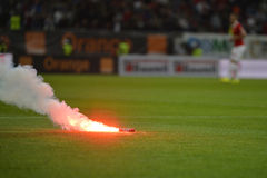 Flare on football pitch. During the match between Dinamo Bucharest and Steaua Bucharest, Romania First Football Division Stock Photography
