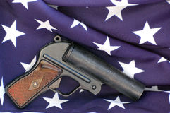 Flare gun and USA flag Stock Photos