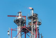 Flare stack. Industrial flare stack with fire flame in some country royalty free stock photos