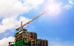 Flare lighting Construction site with cranes on sky background Royalty Free Stock Images