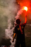 Flare in man hand. On football leage Royalty Free Stock Image