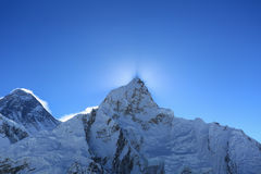 Flare over nuptse summit beside of everest Royalty Free Stock Image