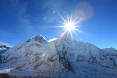 Flare over nuptse summit beside of everest Royalty Free Stock Photos