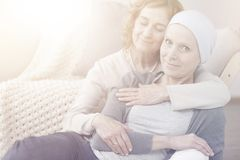 Flare photo of women. Flare photo of two women hugging and spending time together Royalty Free Stock Photo