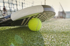 Flare Racket. Paddle Tennis racket, ball and net with flare light Stock Image