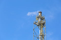 Flare stack with blue sky Stock Photo