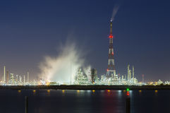 Flare Stack and Harbor Industry At Night Stock Photo