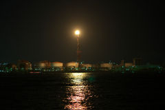 Flare stack in Kawasaki. Watching factories from canal is quite popular in Japan Royalty Free Stock Photography