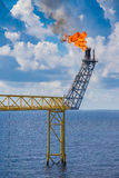 Flare stack of oil and gas central processing platform. Royalty Free Stock Image