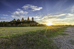 Flare sunset with temple Thailand Stock Photography