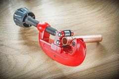 Flared pipes pipe cutter on wooden board.  Stock Images