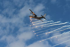 Hercules plane dropping flares Stock Images