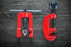 Flaring clamp tube cutter on wooden board.  Stock Photo