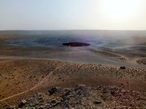 Flaring Gas Crater in Turkmenistan. During the day Royalty Free Stock Photos