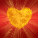 Flaring heart. Burning heart on a red background Stock Photos