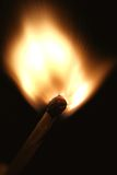 Flaring match. A match has been struck and is flaring, with match head visible Stock Photography