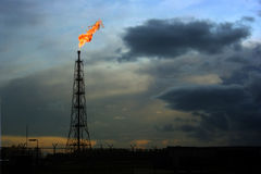 Flaring natural gas location. Flames of burning natural gas at desolate gas well stock image