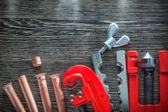 Flaring tool set on wooden board.  Royalty Free Stock Images