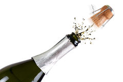 Flasche Champagner mit spritzt Stockbild