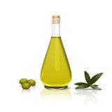 Flasche des Olivenöls und der Niederlassung Stockfotos