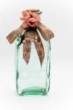 Flasche mit einem Bogen Stockfoto