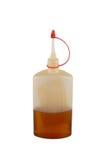 Flasche mit Schmieröl. Lizenzfreies Stockfoto