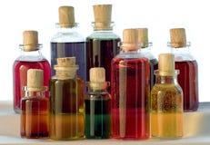 Flaschen auf hölzernem Hintergrund Lizenzfreies Stockfoto