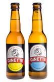Flaschen blondes Belgier-Ginette natürliches und weißes Bier Stockfotos