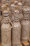 Flaschen eingewickelt mit Flechtweide Lizenzfreies Stockbild