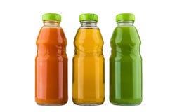 Flaschen mit Karotte, Kiwi und Apfelsaft Stockfotografie