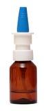 Flaschen mit nasalen Tropfen des Sprays lokalisiert auf Weiß Lizenzfreie Stockfotos