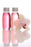Flaschen mit wesentlichen Schmierölen lizenzfreie stockfotos