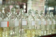 Flaschen mit wesentlichen Schmierölen Lizenzfreies Stockfoto