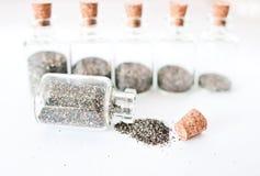 Flaschen und Sand Stockbilder