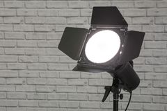 Flash with barn doors Photo equipment strobe on the stand in th stock images