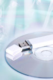 Flash drive and cd or dvd. USB flash drive and cd or dvd Royalty Free Stock Images