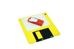 Flash drive and floppy disk. Old technology Yellow floppy disk under orange flash drive Royalty Free Stock Photos