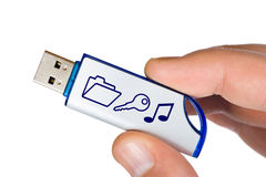 Flash drive with symbols in hand Stock Photo